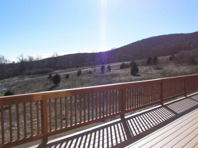 Cedar Siding Custom Home deck with bright sun