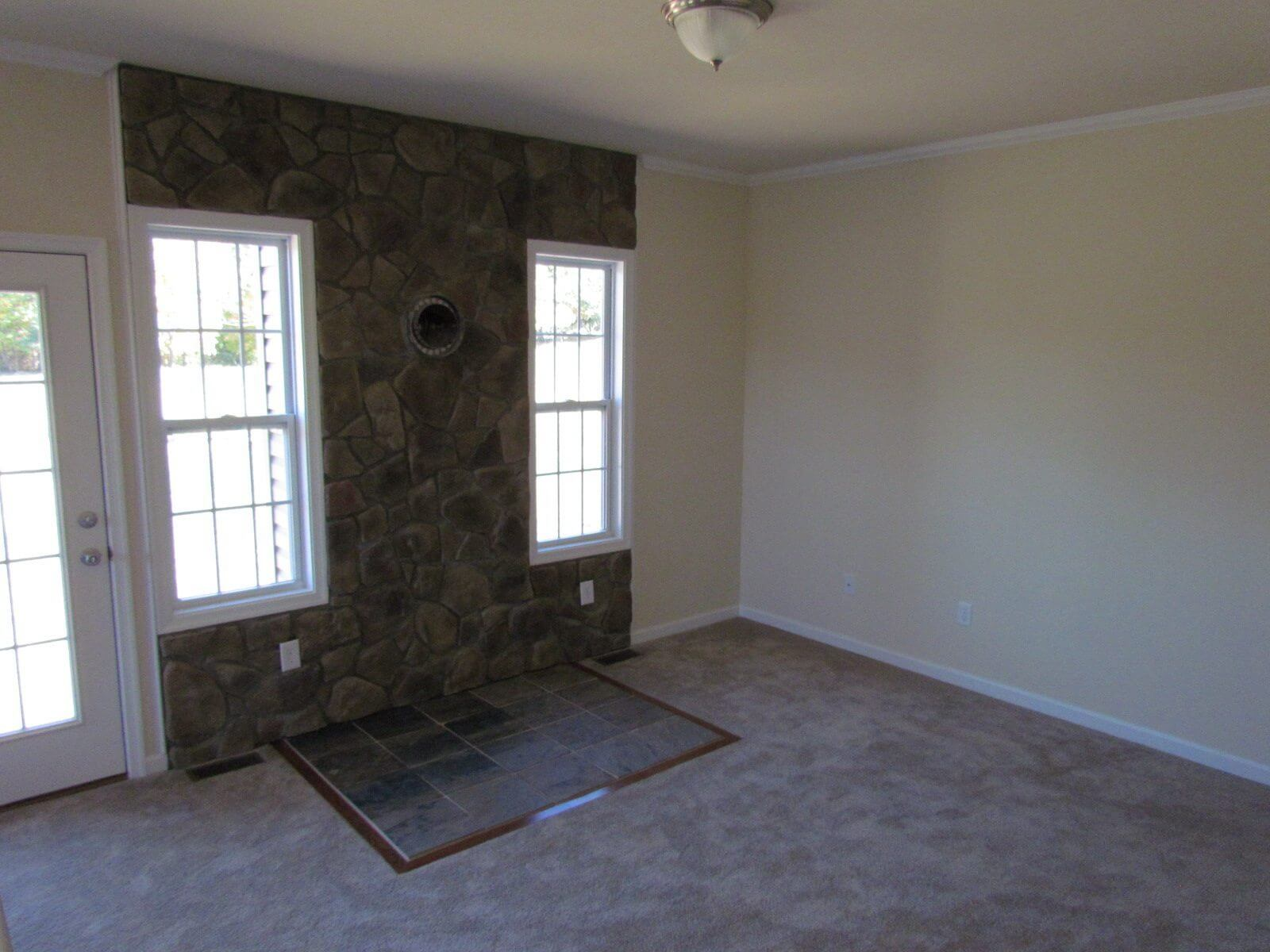 Ashton Custom Home Rancher wood stove area