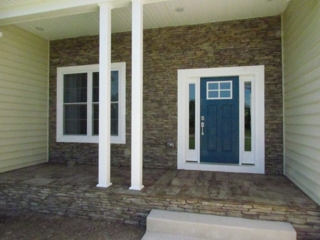 Custom Home With In-Ground Pool front door