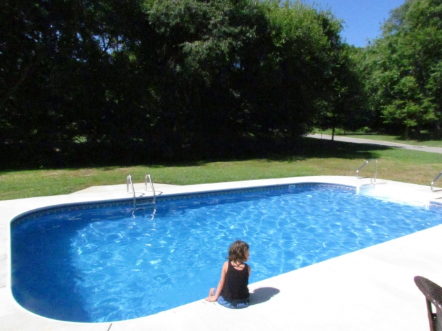 Custom Home With In-Ground Pool kid at pool