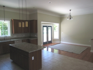 Custom Home With In-Ground Pool kitchen island and back door