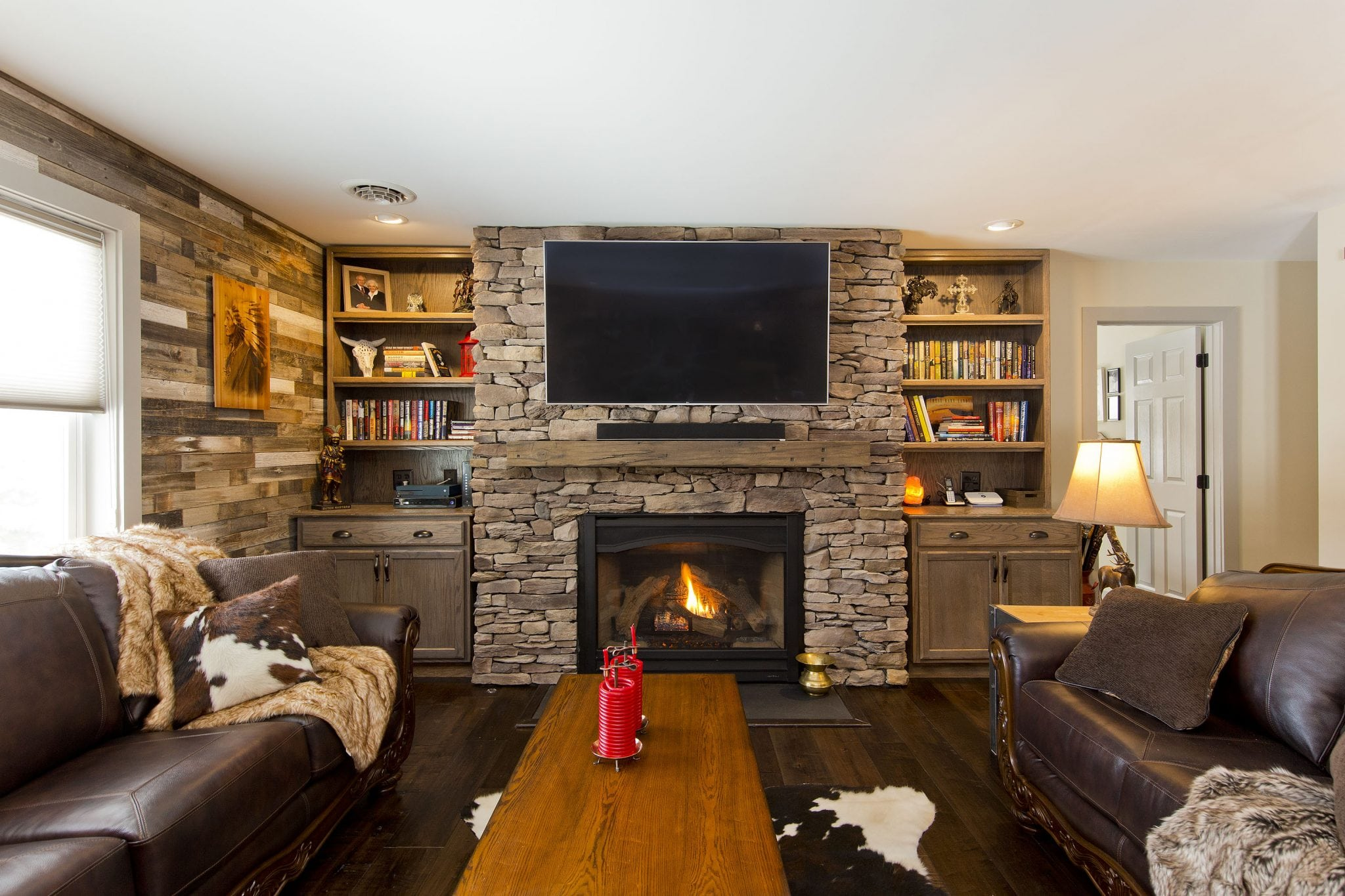 Beautiful renovation with stone fireplace and leather couches