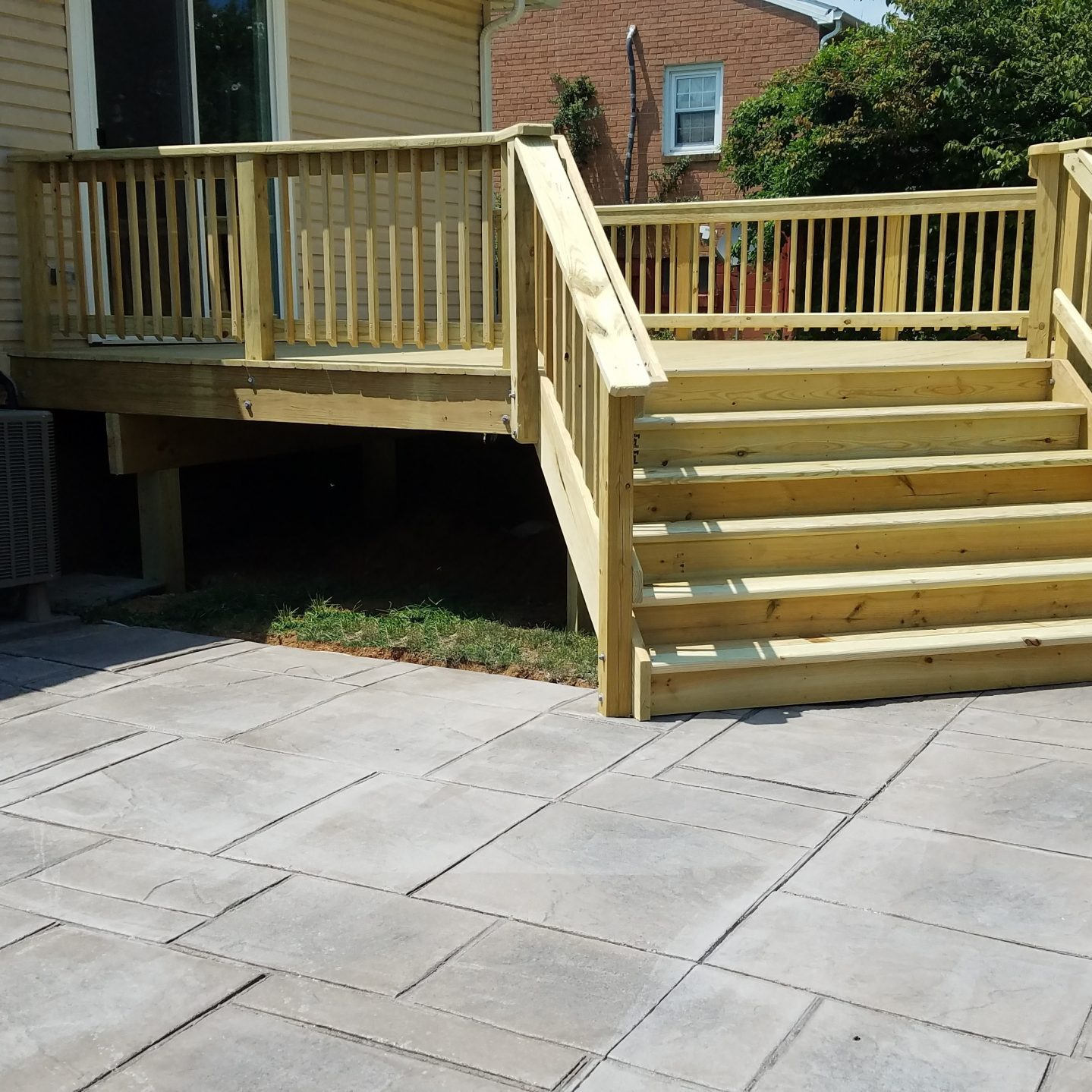 pressure treated deck and stamped concrete patio